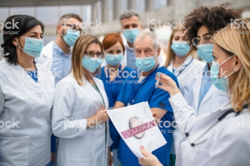 A group of doctors talking about corona virus on conference.